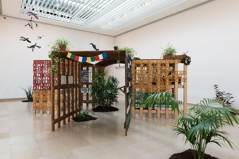 Anna Boghiguian, Jardin de l'inconscient, 2016, Installation wood, wax and pigments, plant, soil. Dimensions variable. Courtesy of Artes Mundi 8.