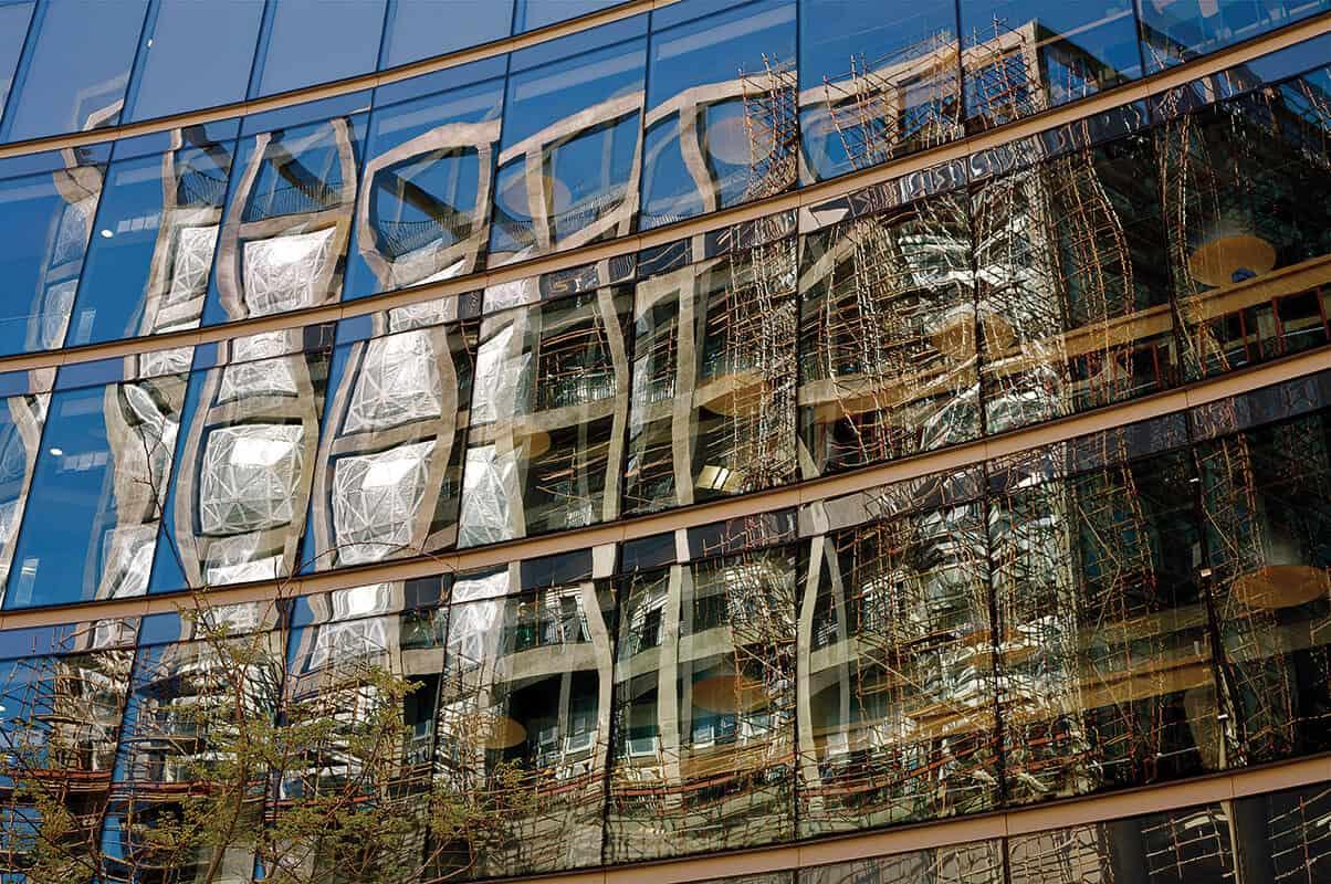 Herman van Wyk's photograph of Zeitz MOCAA under construction in the reflection of surrounding buildings. © Herman van Wyk, image courtesy of the photographer.