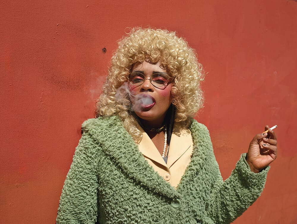 Pieter Hugo, Smoking Orange, 2014. C-print, 137 x 103 cm, Edition of 7 + 2AP. Image courtesy of the artist.