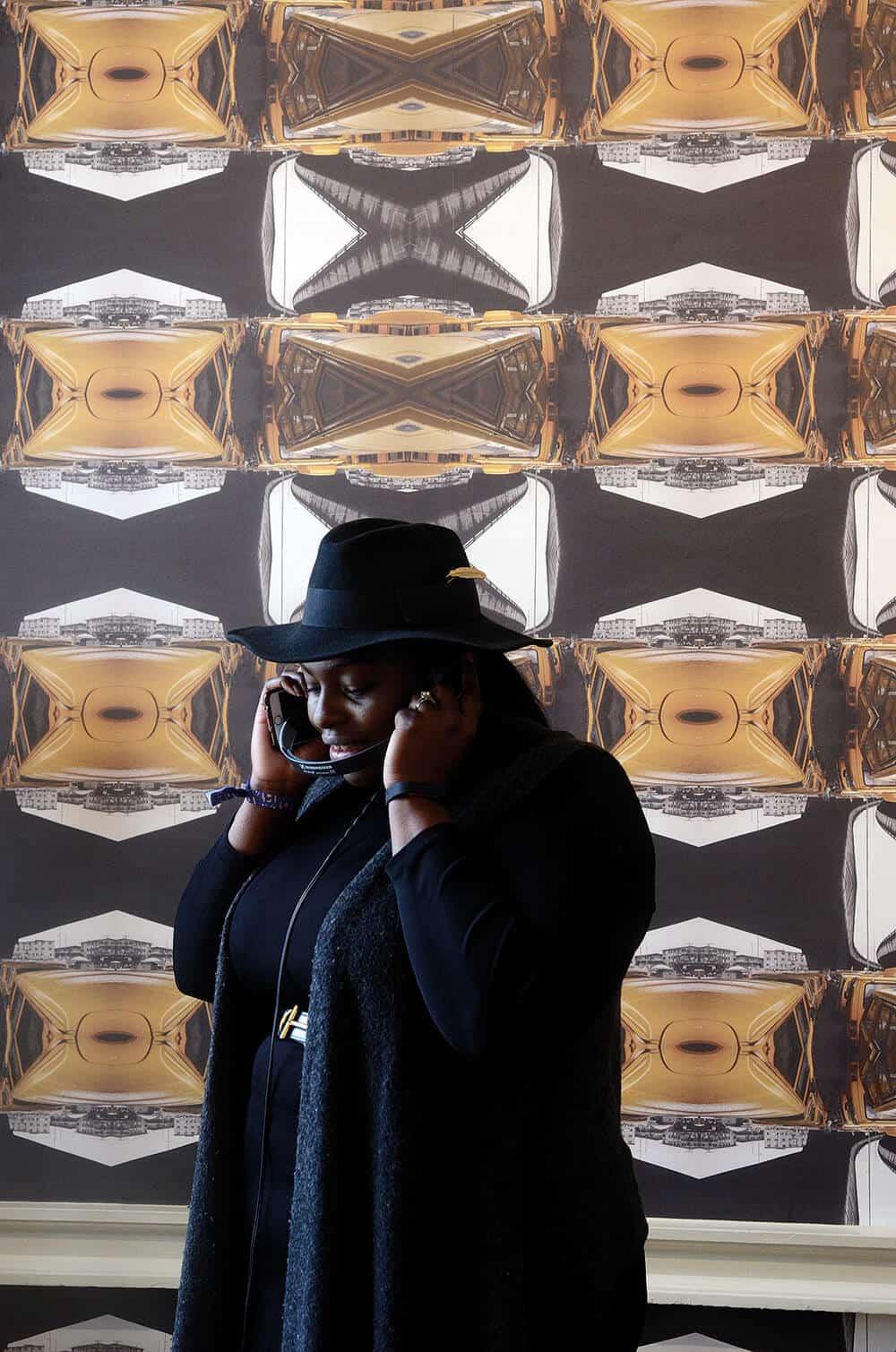 Participant listening to sounds of Ebube Dike. © Kara Blackmore. Courtesy of the photographer.