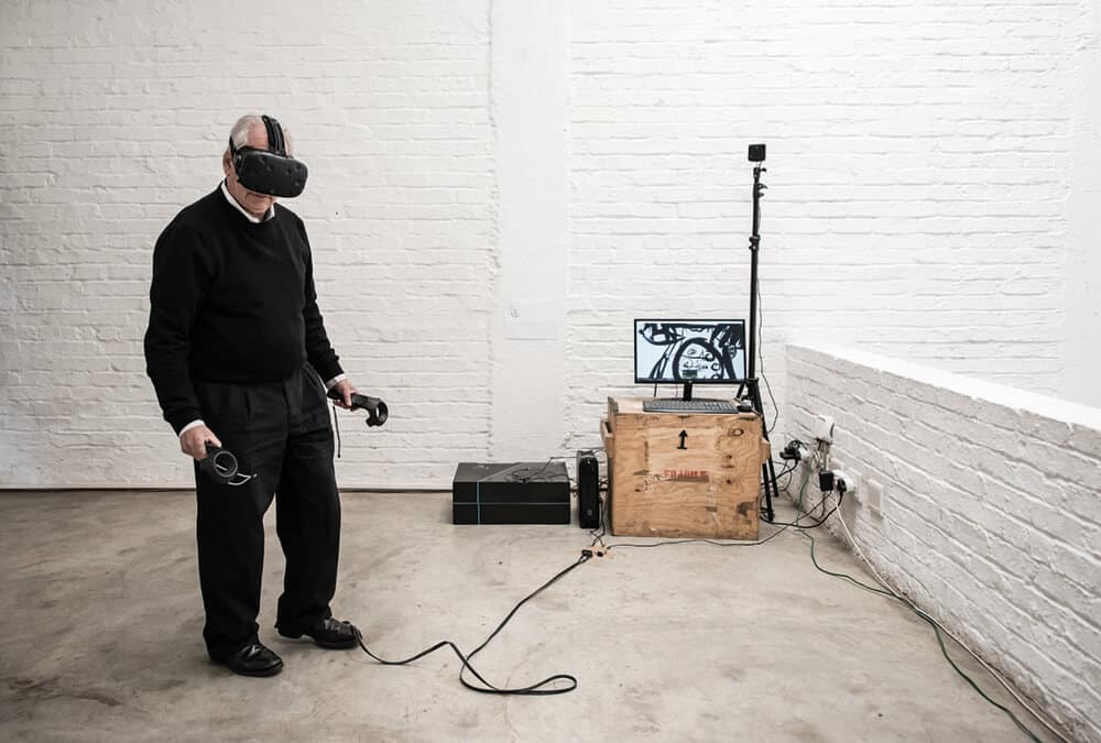 William Kentridge experiences Virtual Reality headset with Tiltbrush drawings, 2017. Photograph: Stella Olivier, image courtesy of the Centre for the Less Good Idea.