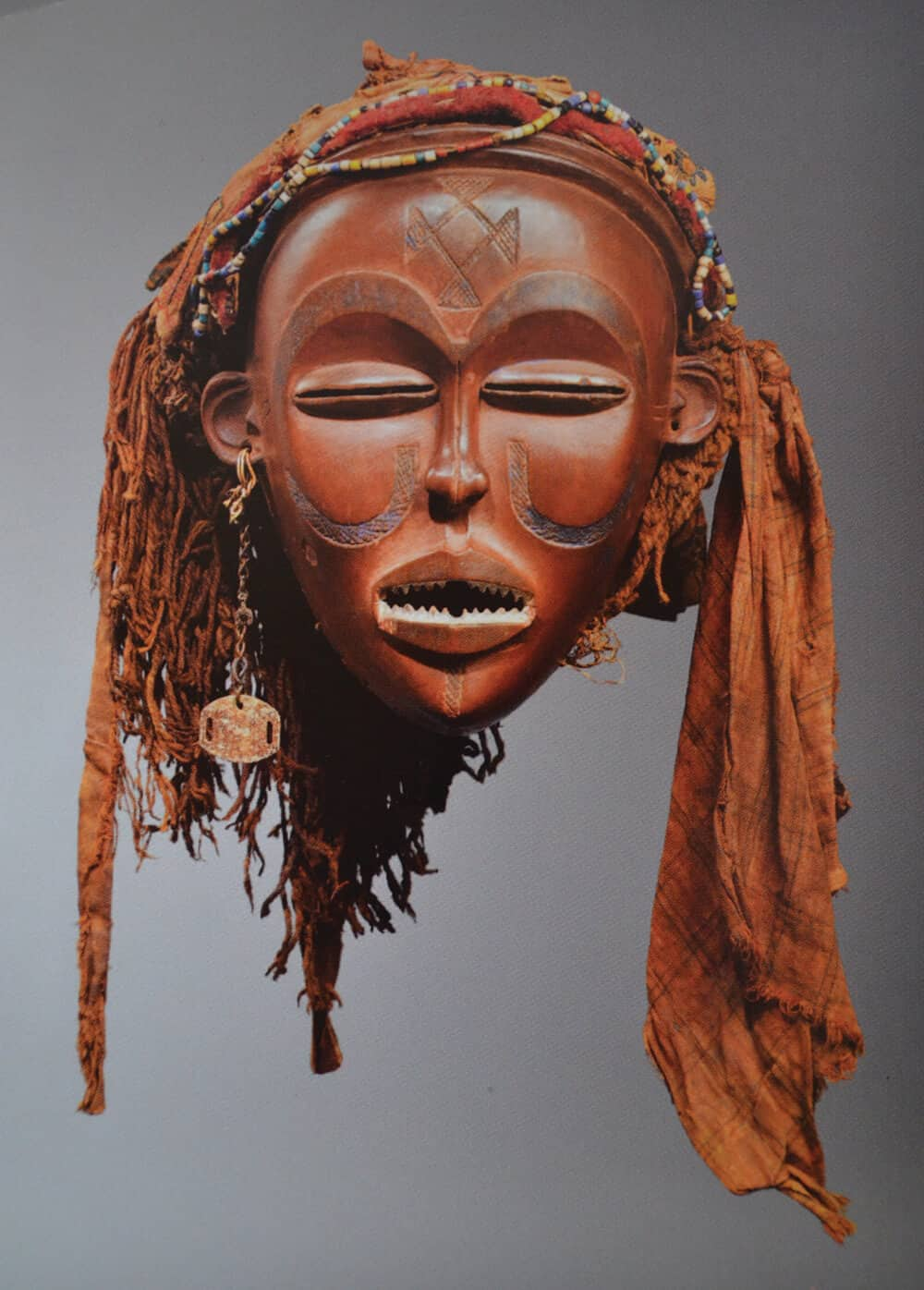 Mwana Pwo Mask Three (Chokwe) D.R.Congo / Angola, wood, c. end of the 19th century to the beginning of the 20th century. Image courtesy of  Fundação Sindika Dokolo.