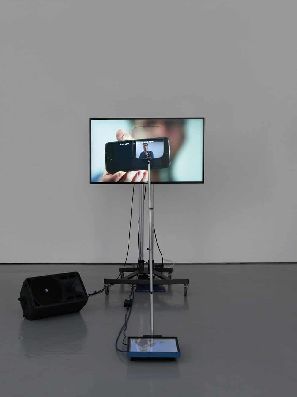 Lawrence Abu Hamdan, Contra Diction (speech against itself), 2015. Two channel video installation, teleprompter, screen, speaker variable dimensions. © Lawrence Abu Hamdan. Courtesy Maureen Paley, London.