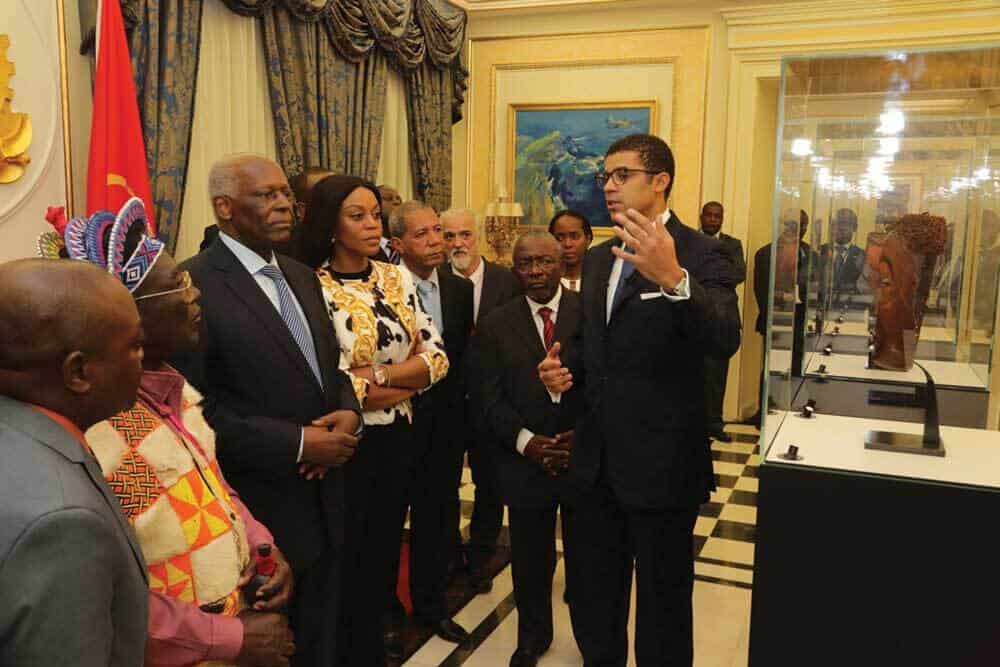 This is an image during the official Ceremony in Luanda where 3 stolen pieces from Dundo Museum have been officially presented to the Angolan authorities on the very symbolic date for Angola of February 4th in presence of the President of Angola, His Ex. José Eduardo Dos Santos and King of Chokwe, His Majesty King Mwene Muatxissengue Wa-Tembo. This ceremony took place in the Presidential Palace in Luanda. Image courtesy of the Sindika Dokolo Foundation.