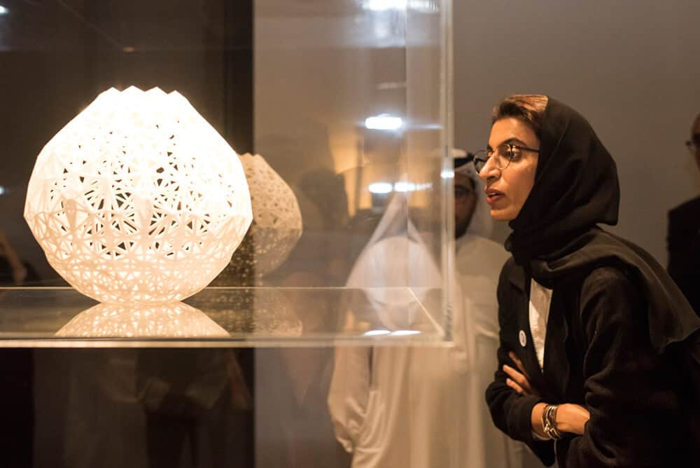 HE Noura Al Kaabi views work by Salem Al Mansoori_Ishara exhibition in Concrete_Image credit Abbi Kemp, courtesy Alserkal Programming and UAE UnlimitedAA-24