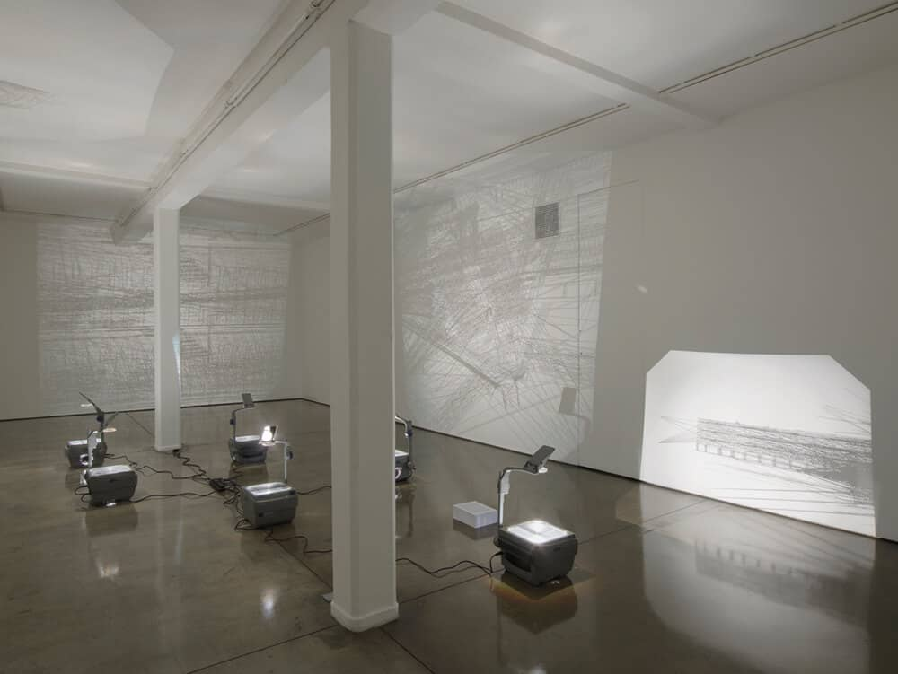 Saydnaya (ray traces), 2017. Inkjet prints on acetate sheets on overhead projectors. Exhibition view at Maureen Paley, London. © Lawrence Abu Hamdan.