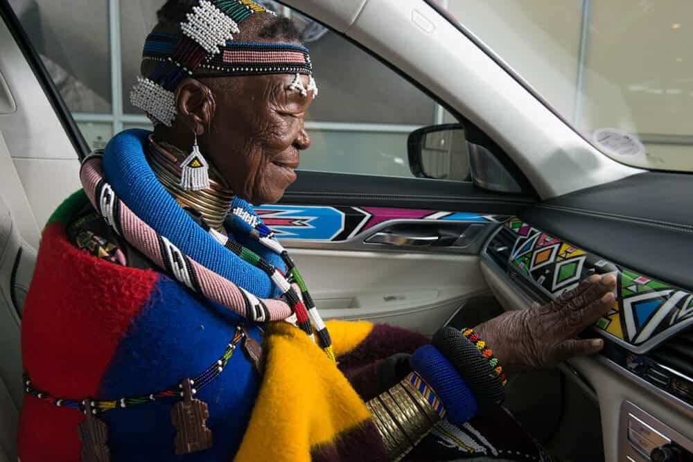 Esther Mahlangu admiring her painting in the BMW 525i Sedan. Courtesy of AG BMW.