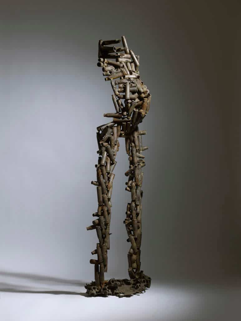 Freddy Tsimba, On a marché dans la forêt, 2005. Mixed technique, recovery, welding sockets, moulded monkey skulls, 182 x 49 x 40 cm. Courtesy of Beaux Arts London.