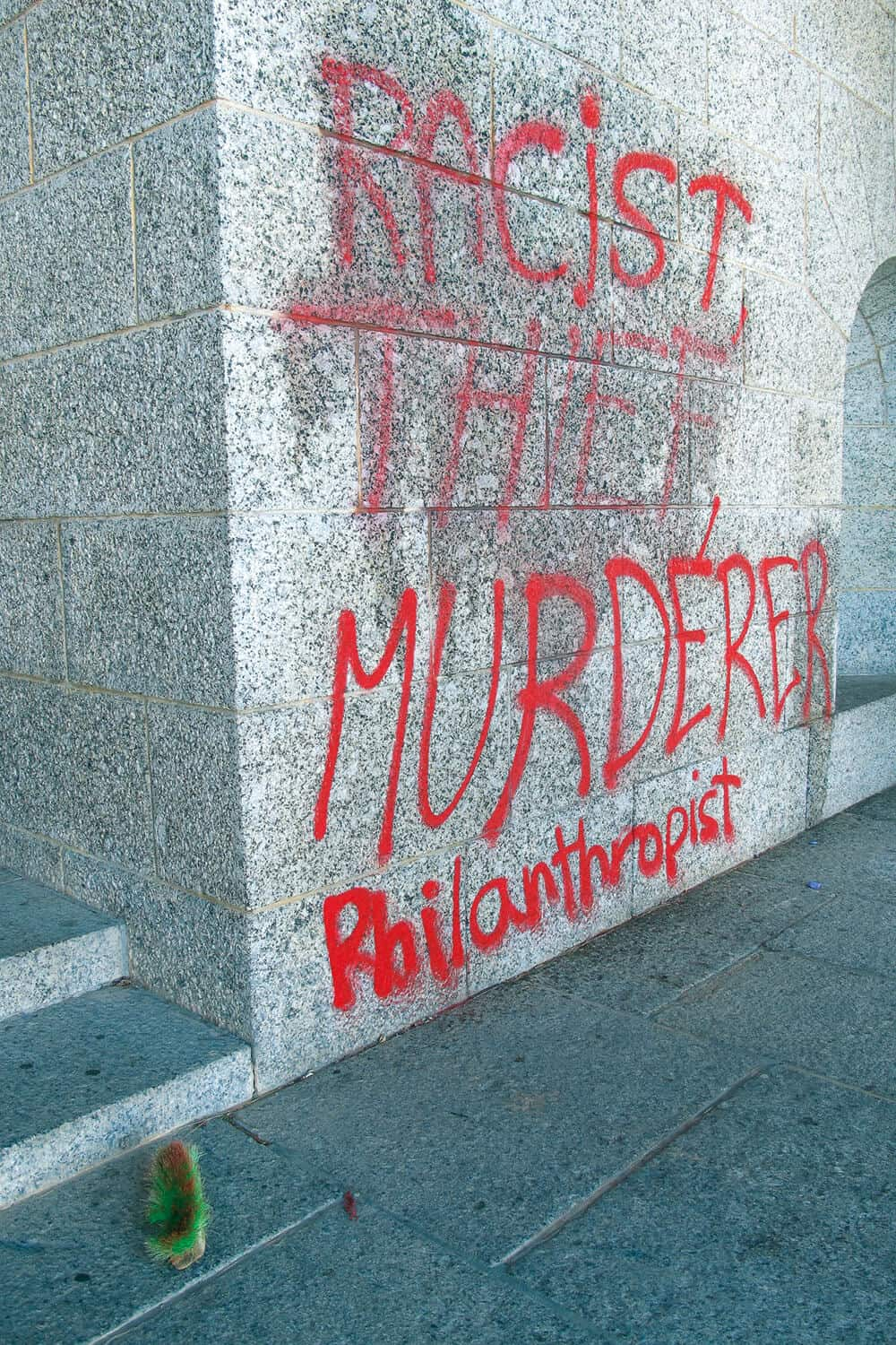 """Racist, Thief, Murderer, Philanthropist"" read graffiti at Rhodes Memorial in Cape Town. Photograph: Kim Gurney"