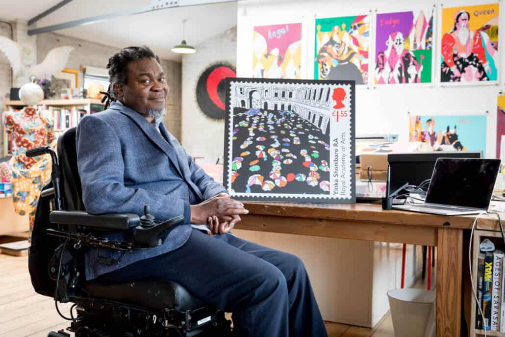 Artist Yinka Shonibare with his Royal Mail stamp at his studio in London.