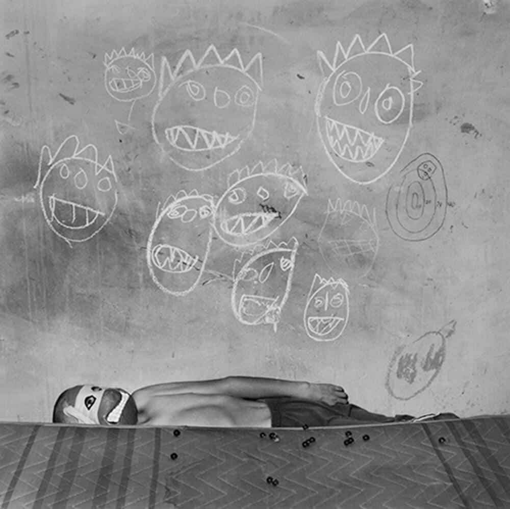 Roger Ballen image which was used for the album cover Generation Freakshow, by the band Feeder.