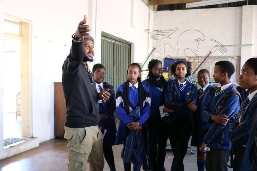 Blesing Ngobeni talking with students