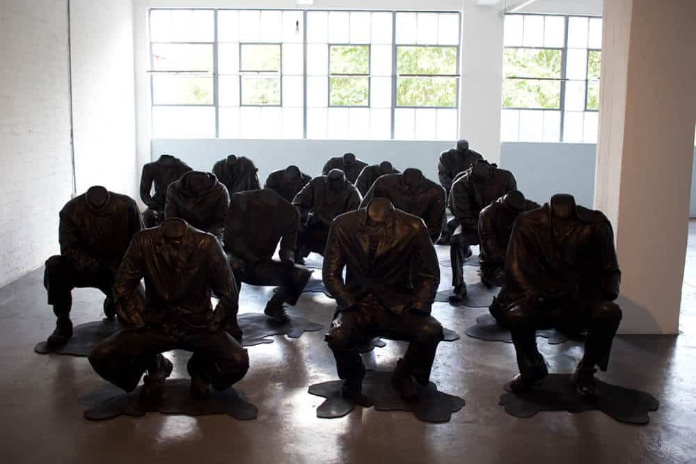 Haroon Gunn-Salie, Senzenina, 2018. Sculptural installation with sound element, 17 life-size crouching figures. Each Figure: 27.6 x 39.4cm. Courtesy of the artist & Goodman Gallery.