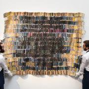 Sotheby's gallery technicians with El Anatsui's Tagomizor