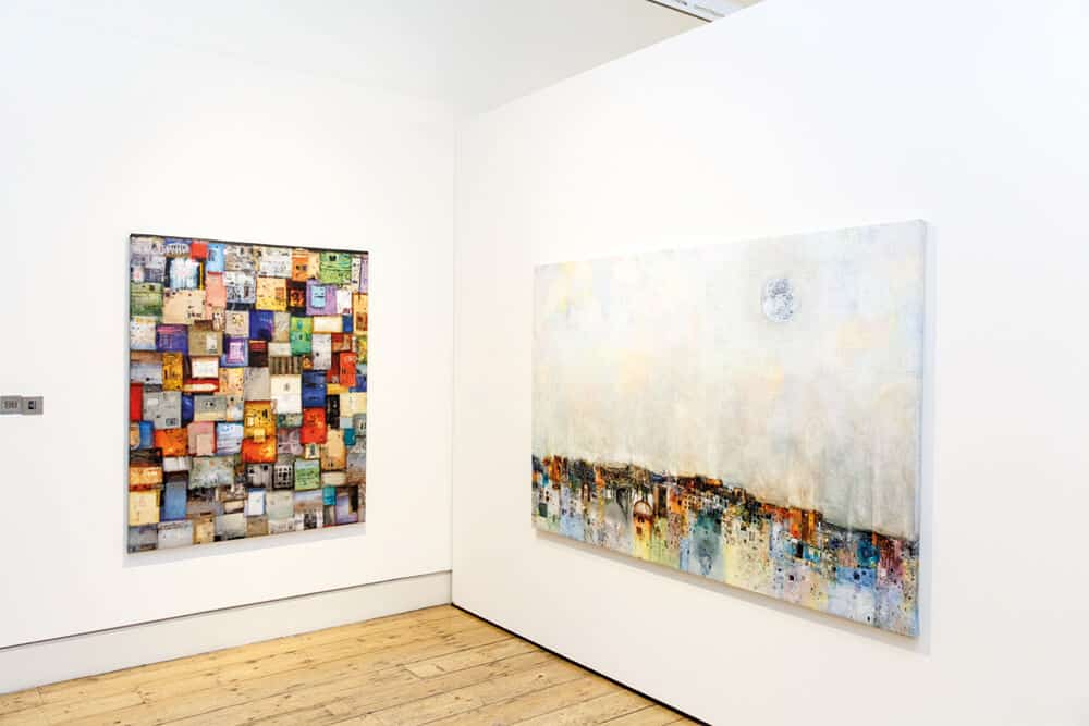 Addis Gezehagn installation shot at 1-54 Contemporary African Art Fair. Floating City XI, 2018, Acrylic and paper on canvas, 146 x 222cm (left). Floating City IV, 2018. Acrylic and paper on canvas, 162 x 130cm (right). Courtesy of the artist & Addis Fine Art.