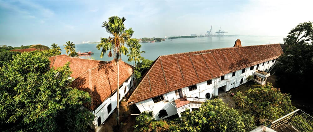 Aspinwall House is a large sea-facing heritage property in Fort Kochi. The property was originally the business premises of Aspinwall & Company Ltd. established in 1867 by English trader John H Aspinwall. Under the guidance of Aspinwall the Company traded in coconut oil, pepper, timber, lemon grass oil, ginger, turmeric, spices, hides and later in coir, coffee, tea and rubber. The large compound contains office buildings, a residential bungalow and a number of warehouses and smaller outer-lying structures. Aspinwall House is the primary venue of the Biennale, hosting numerous artist led projects and events spaces.
