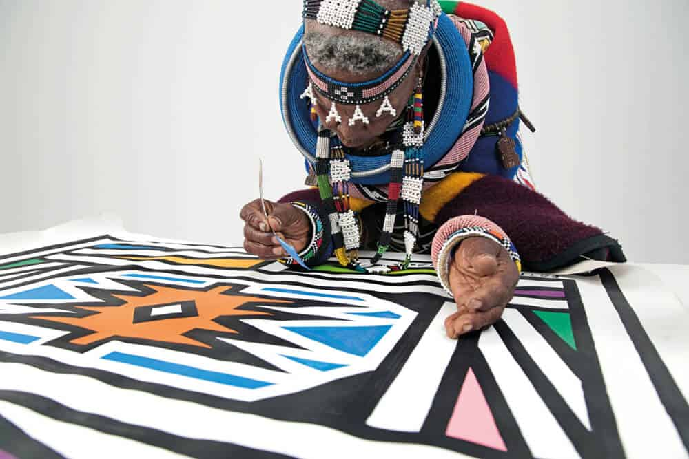 Artist and cultural icon, Dr. Esther Mahlangu photographed by Clint Strydom, 2018. Courtesy of The Melrose Gallery
