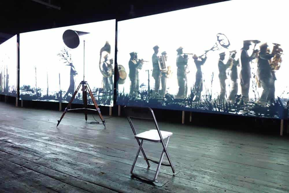 Instllation view of William Kentridge's eight-channel video, More Sweetly Play the Dance, 2015. Photographer: Sean O'Toole.