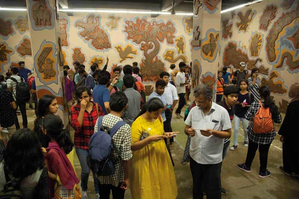 Durgabai and Subhash Vyam, installation view with crowds at Kochi-Muziris Biennale 2018. Courtesy of Kochi Biennale Foundation
