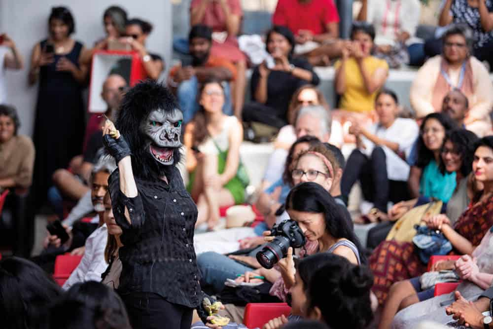 Guerrilla Girls perofrmance, The Pavillion, Kochi-Muziris Biennale 2018. Courtesy of Kochi Biennale Foundation. The story goes that the Guerrilla Girls were originally meant to wear ski masks to hide their faces but when one of their gang accidentally spelt guerrilla wrong and wrote gorilla, they thought it would be funny to wear monkey masks instead.