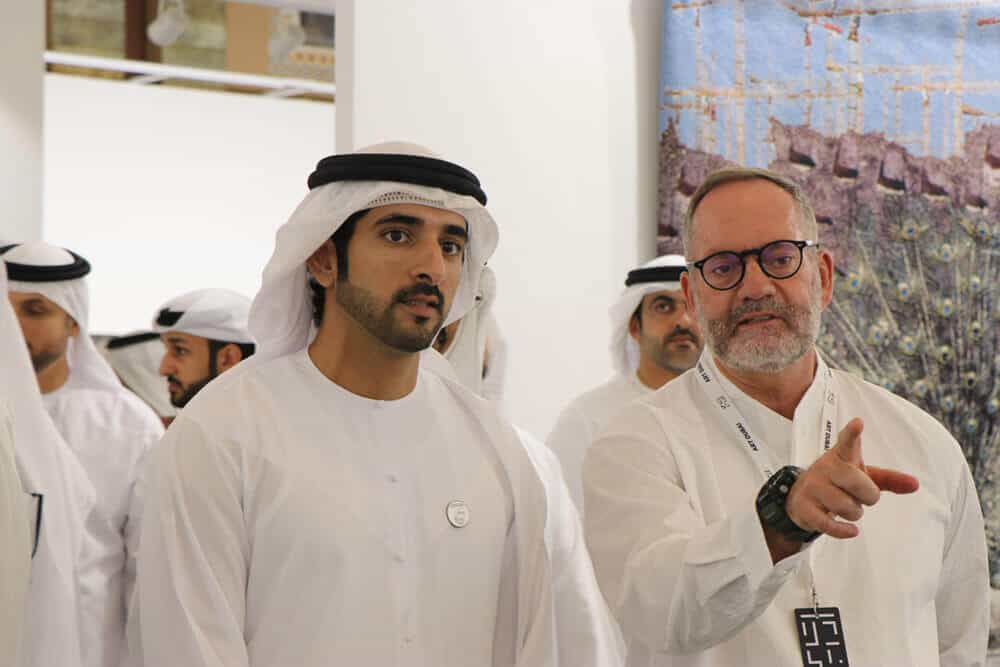 Sheikh Hamdan bin Mohammed bin Rashid Al Maktoum, Crown Prince of Dubai, United Arab Emirates and Pablo del Val, artistic director, Art Dubai view the galleries as part of the official opening of Art Dubai 2019. Image courtesy of Brendon Bell-Roberts.
