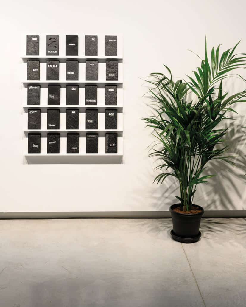 Candice Breitz, Digest. 2019. Multi-channel video installation, wooden shelves, videotape, polypropylene boxes, paper, acrylic paint 300 units: 20.3 x 12 x 2.7 cm each. Commissioned by Sharjah Art Foundation. Courtesy of Goodman Gallery, Johannesburg; Kaufmann Repetto, Milan and KOW, Berlin
