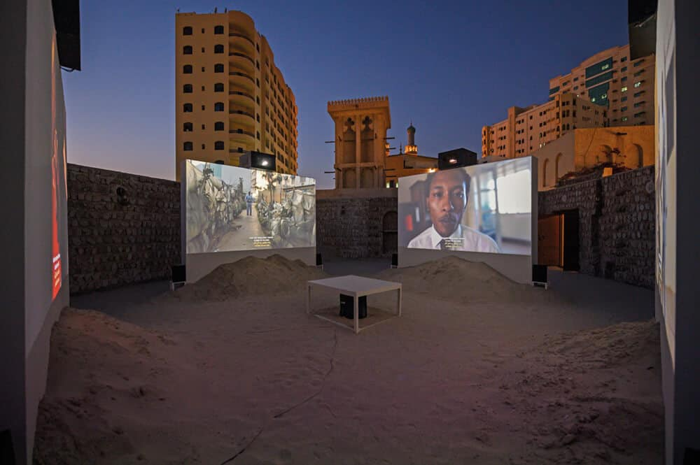 Tuân Andrew Nguyên, The Specter of Ancestors Becoming, 2019. 4-channel video installation: colour, 7.1 surround sound; inkjet on canvas, oil on canvas, graphite on paper, C-prints, sand, 28 minutes, dimensions variable. Commissioned by Sharjah Art Foundation. Produced by Sharjah Art Foundation with additional production support from San Francisco Museum of Modern art.Courtesy of the artist and James Cohan, New York