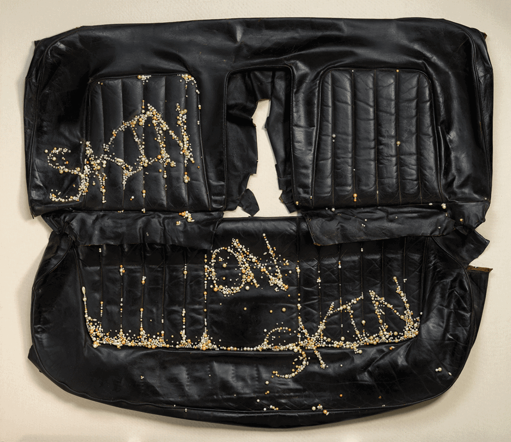 Frances Goodman (b. 1975, Johannesburg, South Africa), Skin on Skin, 2012. Faux pearl earrings, found leather car seat, adhesive. Museum purchase, 2016-17-1.