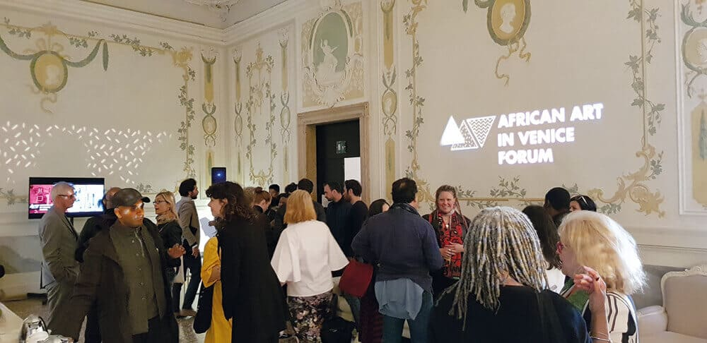 Participants & Audience waiting mingling before 'African Art in Venice Forum' starts. The Forum took place 7-9 May 2019 at Hotel Monaco & Grand Canal Venice, Italy. Photographer: Marcus Gora