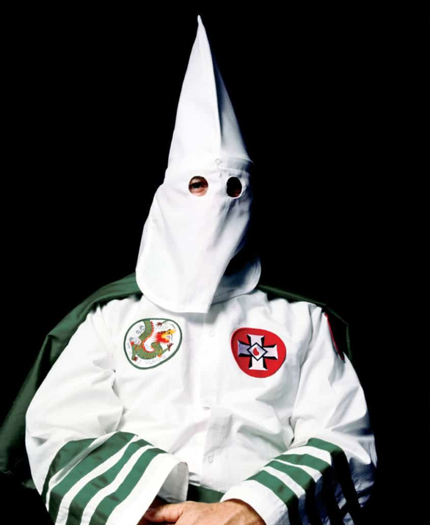 Cuban artist Andres Serrano is a descendant of the Africans who were kidnapped and forced into slavery in the New World. Serrano's portrait of the Ku Klux Klan grand masters inverts the cliché about masking traditions as the black man photographs white supremacists on the other side of the mask.