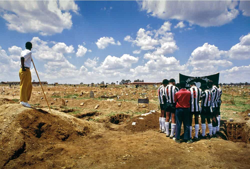 Soccer Grave, Ratanda, 1993. A football team buries their team-mate who was killed in crossfire between ANC and IFP fighters while playing soccer in Heidelberg's Ratanda Township. The political rivalry in Ratanda combined with politically aligned unions vying for jobs in local meat-processing factories resulted in several people being killed in confrontations.
