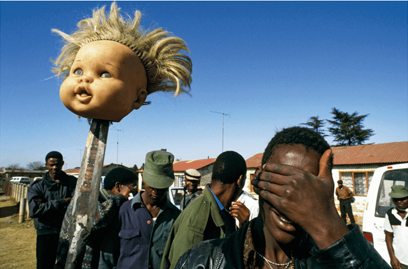 Doll's Head, Boipatong, 1992, A man holds a white doll's head on a spear in the angry aftermath of the Boipatong Massacre of June 1992. Forty-five people were killed by Inkatha Freedom Party members, allegedly supported by police, which nearly derailed the negotiations towards a democratic solution to South Africa's dilemma.