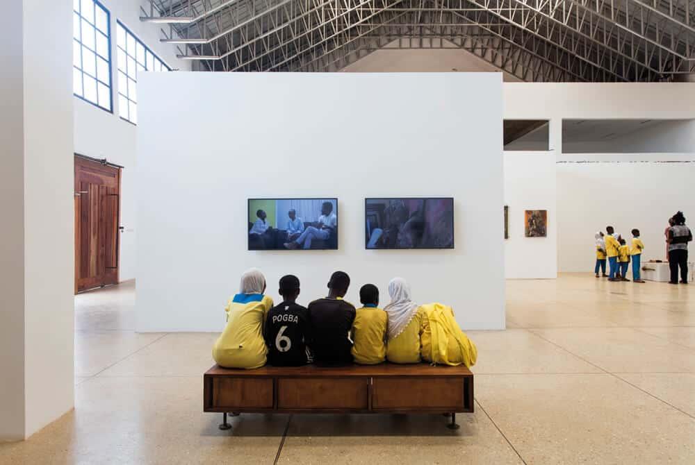 School children engaging with works at Galle Winston Kofi Dawson retrospective, 'Galle Winston Kofi Dawson: In Search of Something 'Beautiful'… perhaps' Photographer: Ibrahim Mahama. Courtesy SCCA-Tamale.