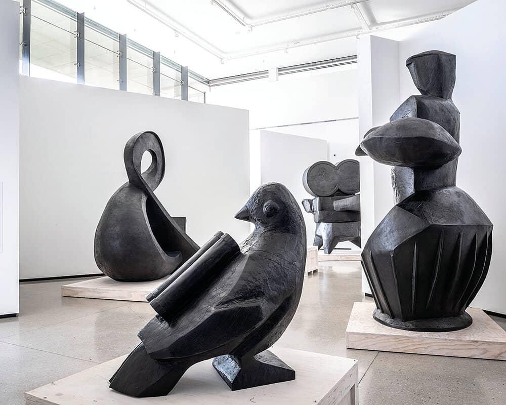 Pigeon (front), 2019. Bronze sculpture, 94 x 95 x 59cm. Cape Silver (middle right), 2018. Bronze sculpture, 364 x 285 x 160cm. & (middle right), 2019. Bronze sculpture, 330 x 299 x 212cm. Courtesy of Norval Foundation. © Dave Southwood.