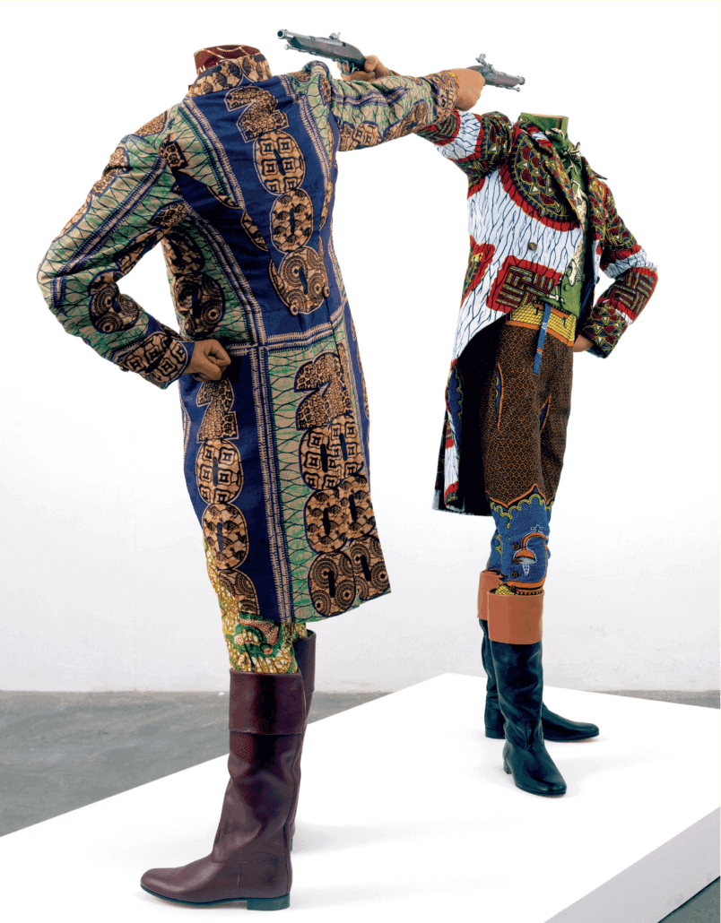 Yinka Shonibare CBE (RA), How to Blow Up Two Heads at Once, 2006. Installation, 2 mannequins, dutch wax printed cotton textile, leather riding boots, plinth, 175 x 245 x 122cm. © Yinka Shonibare, courtesy of Stephen Friedman Fine Art