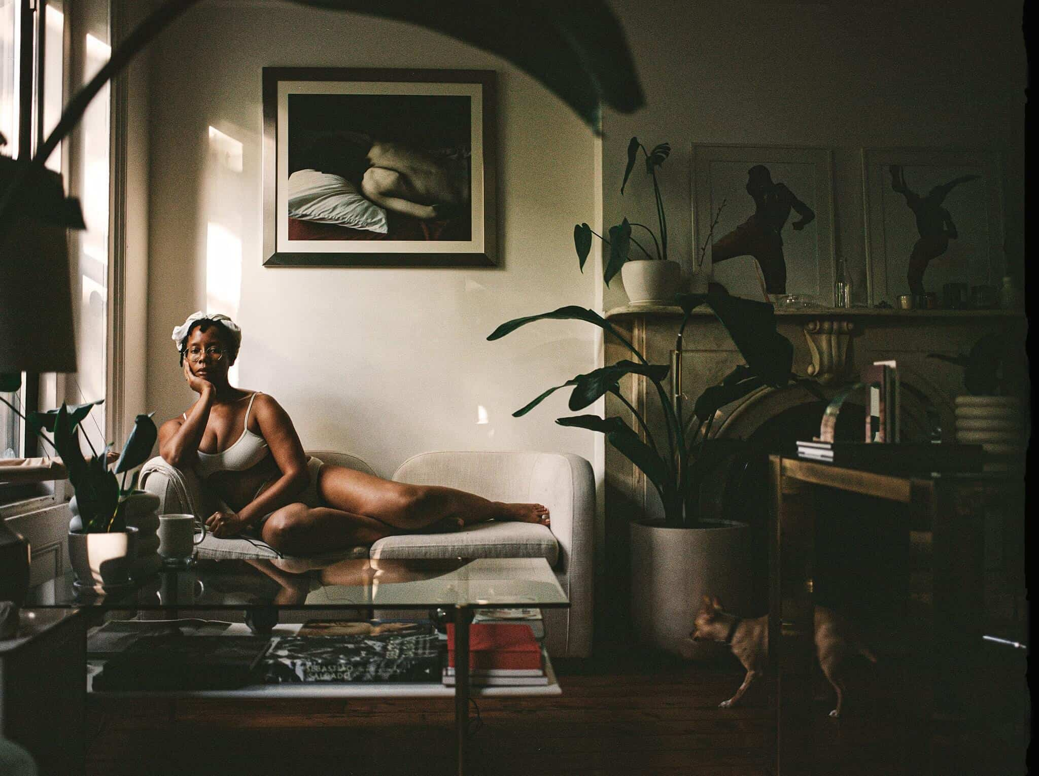 "The photographer Dana Scruggs at home. Her self-portrait is part of the collection ""Sources of Self-Regard: Self-Portraits From Black Photographers Reflecting on America.""Credit...Dana Scruggs for The New York Times"